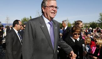 ** FILE ** Former Florida Gov. Jeb Bush and his wife Columba arrives for the dedication of the George W. Bush presidential library on the campus of Southern Methodist University in Dallas, Thursday, April 25, 2013. (AP Photo/Charles Dharapak)