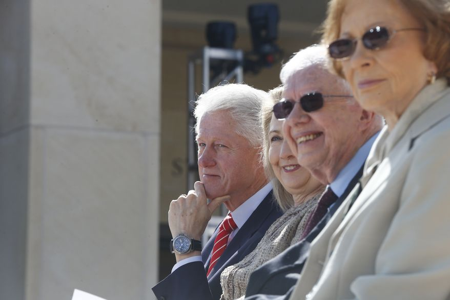 Former President Bill Clinton, left, former first lady Hillary Rodham Clinton, second left, former President Jimmy Carter, second right, and Rosalynn Carter are seated on stage at the George W. Bush presidential library on the campus of Southern Methodist University in Dallas, Thursday, April 25, 2013. (AP Photo/Charles Dharapak)