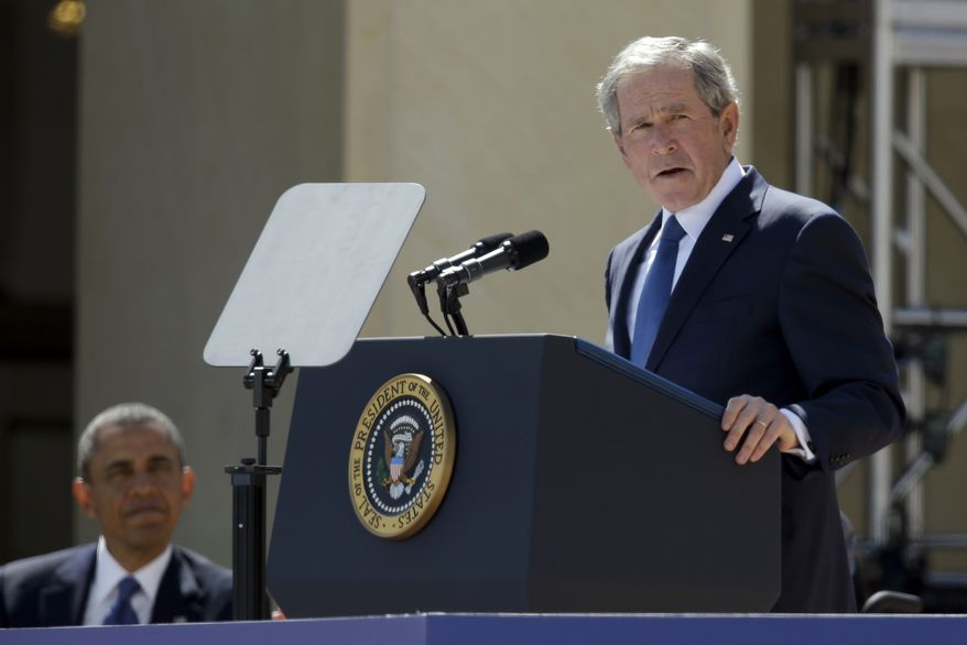 President Barack Obama listens as former President George W. Bush speaks during the dedication of the George W. Bush Presidential Center, Thursday, April 25, 2013, in Dallas. (AP Photo/Tony Gutierrez, Pool)