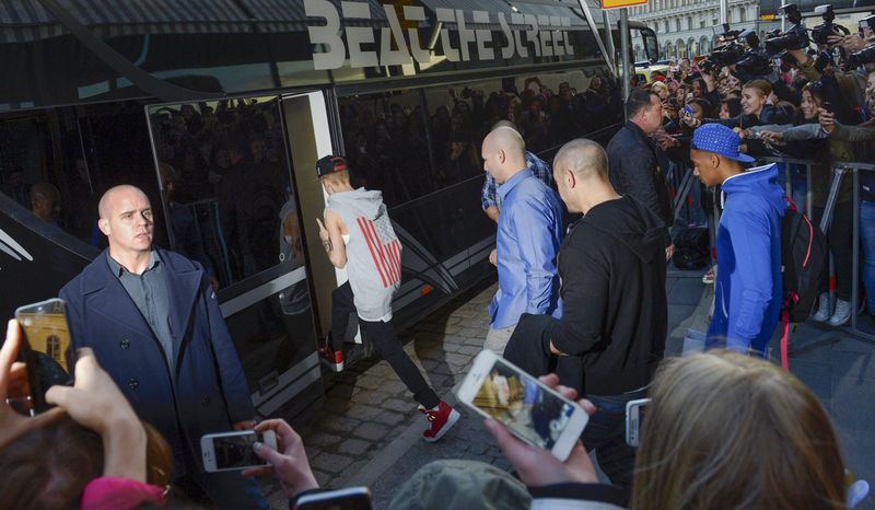 Teen heartthrob singer Justin Bieber boards his tour bus outside the Grand Hotel in Stockholm on Tuesday, April 23, 2013. Swedish police on Thursday said they had found drugs on the bus but