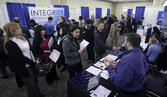Job seekers meet with prospective employers at a job fair in Sunrise, Fla., on Tuesday, Jan. 22, 2013. (AP Photo/J. Pat Carter)