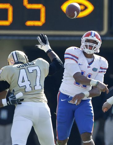 Florida Gators quarterback Jordan Reed (11) passes as he is pressured by Vanderbilt linebacker DeAndre Jones (47) in the fourth quarter of an NCAA college football game on Saturday, Nov. 6, 2010, in Nashville, Tenn. Florida won 55-14. (AP Photo/Mark Humphrey)