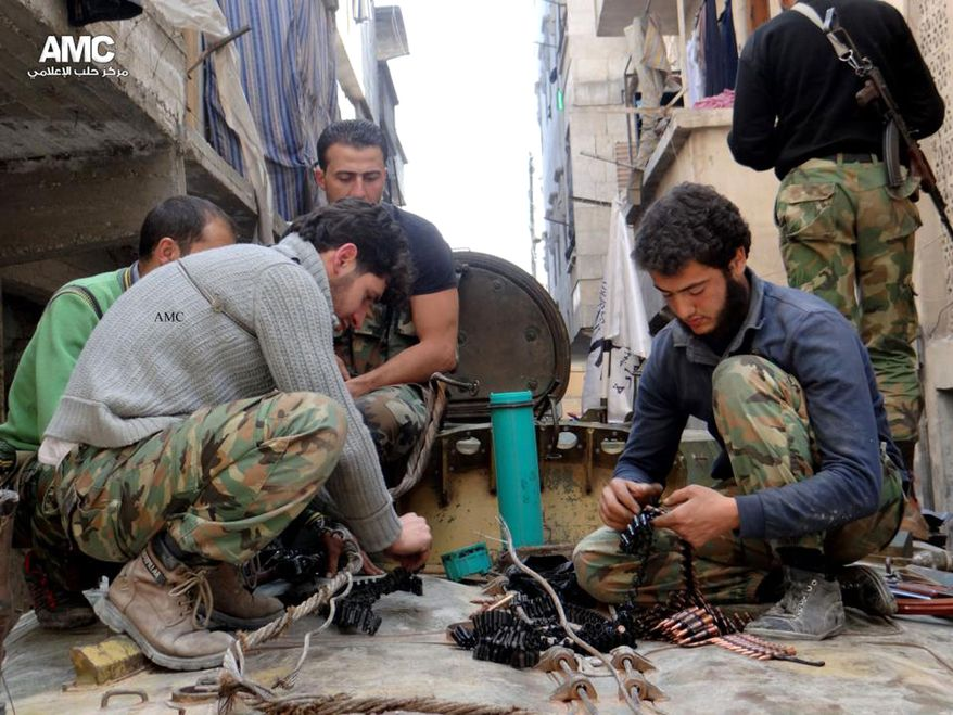 This citizen journalism image taken on April 25, 2013 and provided by Aleppo Media Center AMC, which has been authenticated based on its contents and other AP reporting, shows members of the free Syrian Army preparing their weapons in the neighborhood of al-Amerieh in Aleppo, Syria. (Associated Press/Aleppo Media Center AMC)