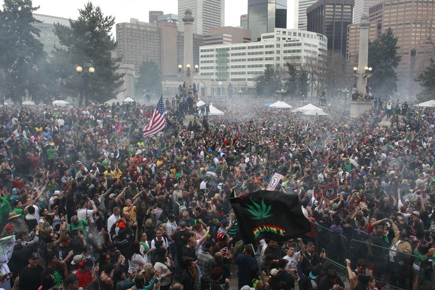 Members of a crowd numbering tens of thousands smoke marijuana simultaneously at 4:20 p.m., at the Denver 420 pro-marijuana rally at Civic Center Park in Denver on April 20, 2013. Even before the passage in November 2012 of Colorado Amendment 64 promised the legalization of marijuana for recreational use, April 20 has for years been a celebration of marijuana counterculture, and the 2013 rally draw larger crowds than previous years. (Associated Press)