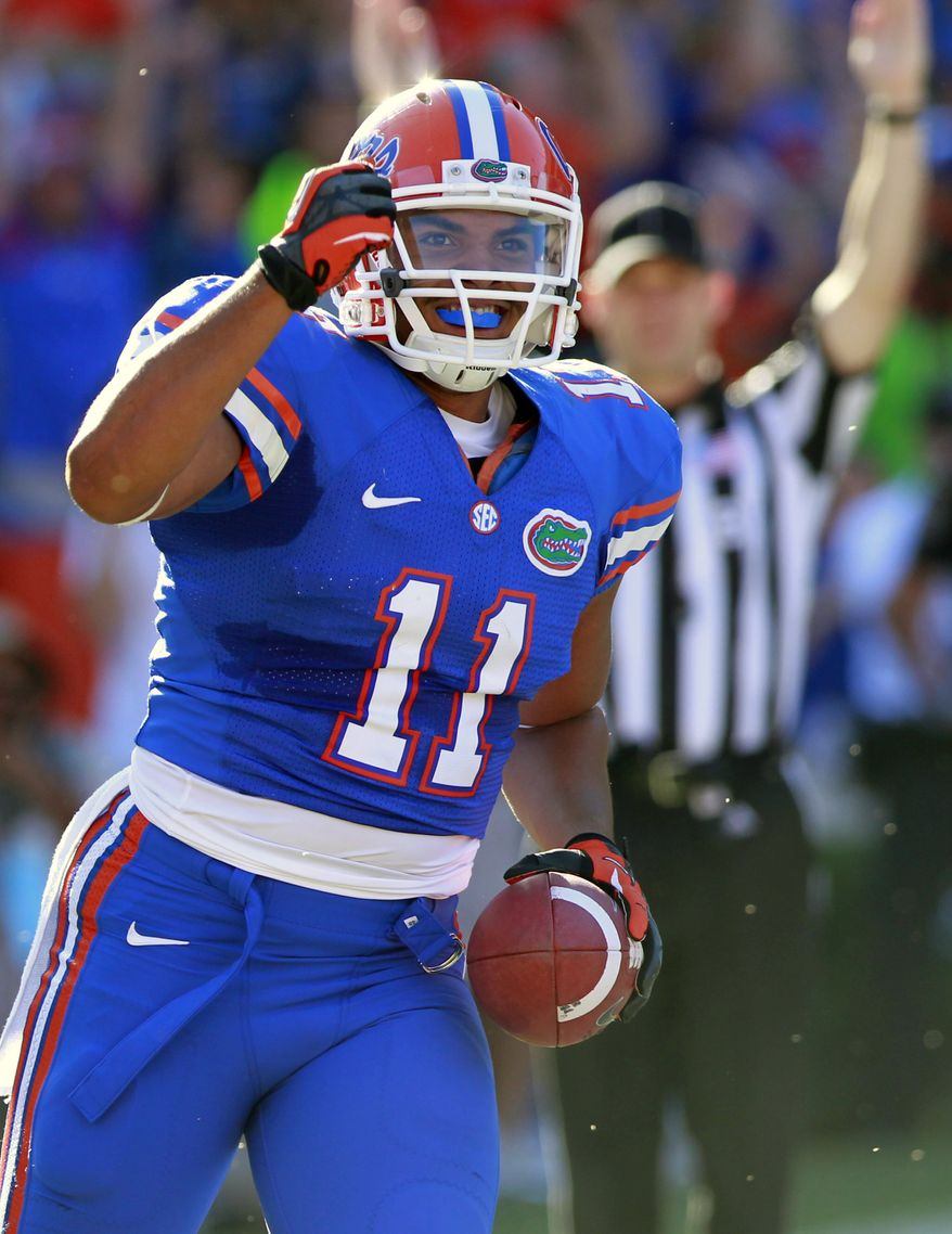 Florida tight end Jordan Reed (11) celebrates after scoring a touchdown on a 1-yard pass against South Carolina during the first half of an NCAA college football game, Saturday, Oct. 20, 2012, in Gainesville, Fla. (AP Photo/John Raoux)