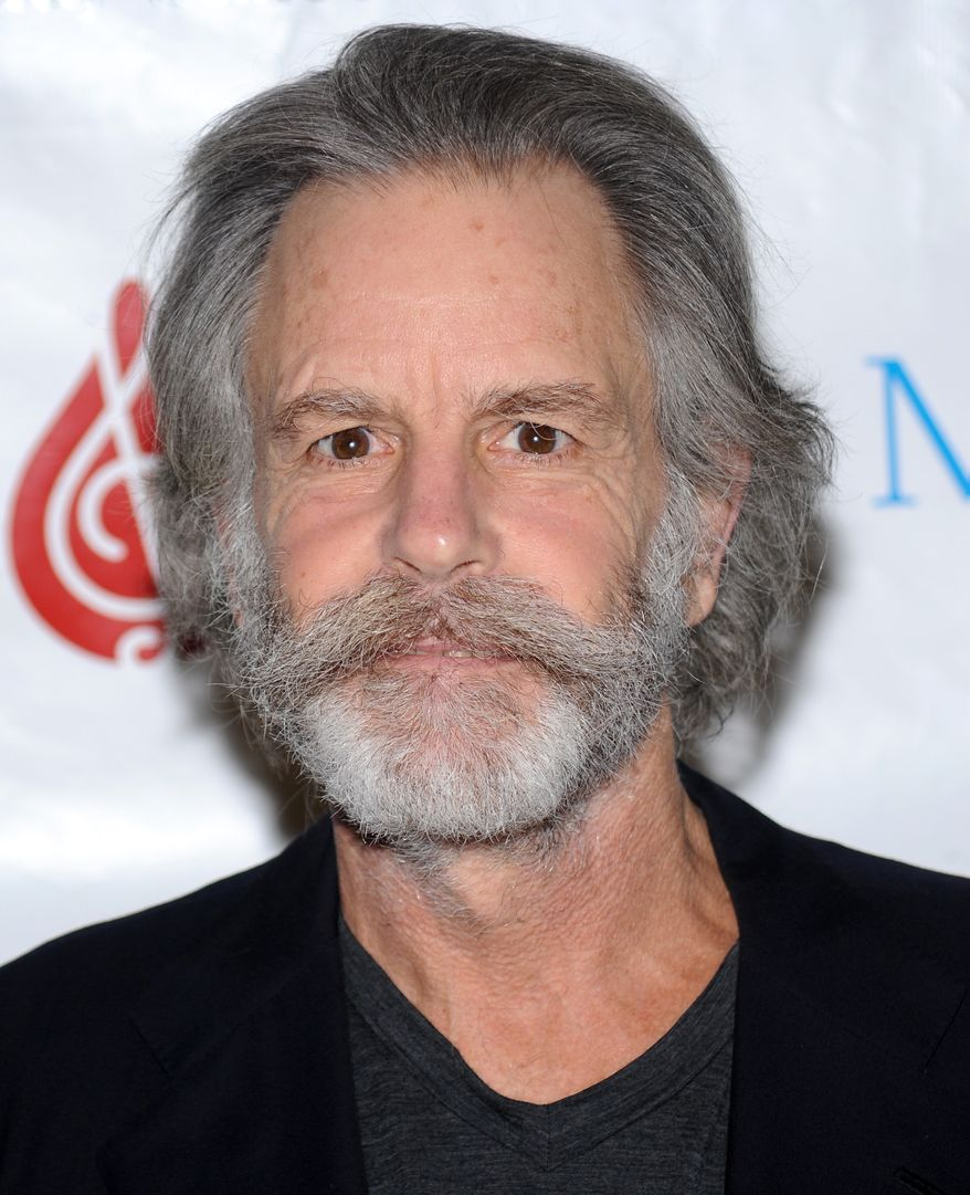 This 2010 photo shows Bob Weir, founding member of the Grateful Dead, who fell onstage while strumming his guitar at a concert in Port Chester, N.Y. In a video posted online, the 65-year-old musician collapsed Thursday during a performance with his Furthur bandmates at The Capitol Theatre. (AP Photo/Evan Agostini, file)