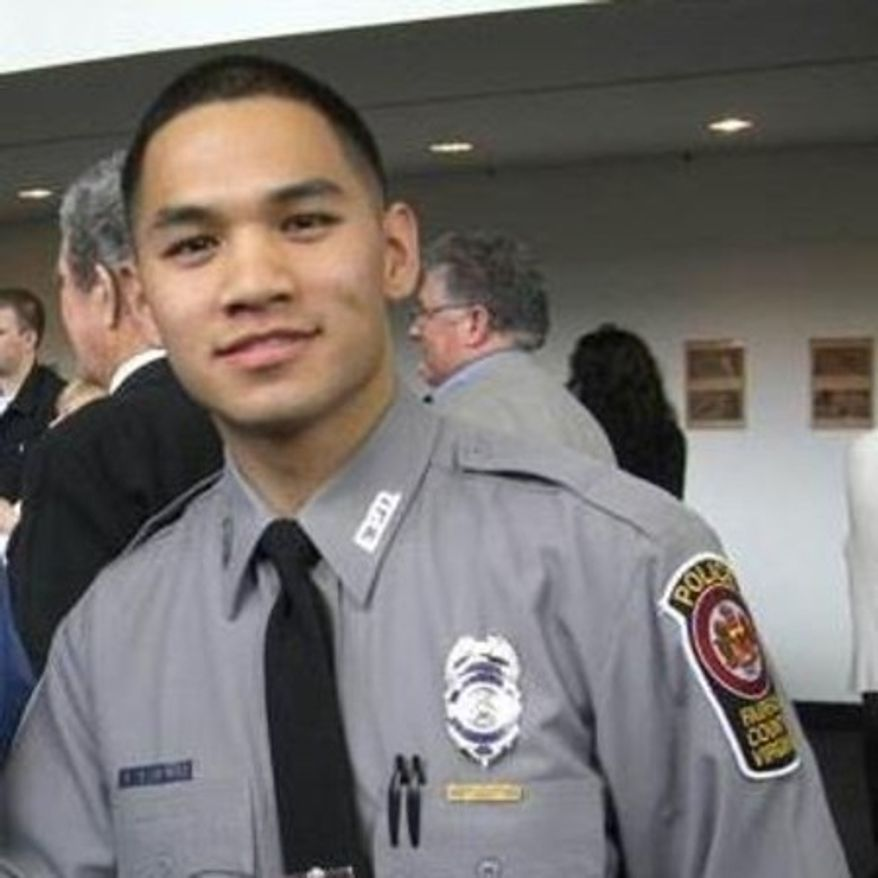 Fairfax County Police Officer Long Dinh Jr. is recovering from injuries suffered during a head-on crash in February (Photo courtesy of Fairfax County Police Department).