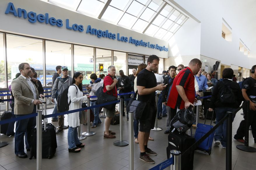 ** FILE ** Travelers stand in line at Los Angeles International Airport on Monday, April 22, 2013. (Associated Press)