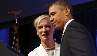 ** FILE ** President Obama is introduced by Cecile Richards, president of Planned Parenthood, before speaking at the 2013 Planned Parenthood National Conference in Washington on April 26, 2013. (Associated Press)