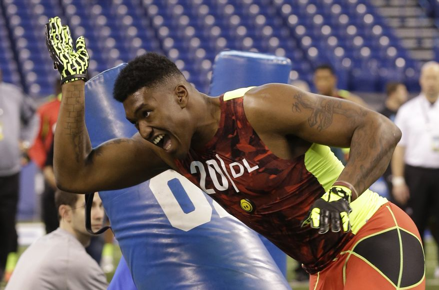 Florida State defensive lineman Brandon Jenkins runs a drill during the NFL football scouting combine in Indianapolis, Monday, Feb. 25, 2013. (AP Photo/Dave Martin)