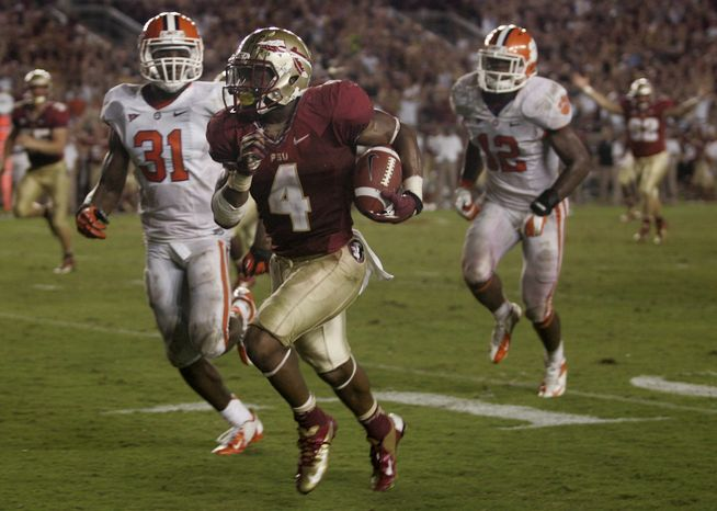 Florida State running back Chris Thompson (4) makes a 24-yard touchdown as Clemson safety Rashard Hall (31) can't catch him during the fourth quarter of an NCAA college football game on Saturday, Sept. 22, 2012, in Tallahassee, Fla. (AP Photo/Phil Sears)