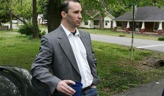 **FILE** Everett Dutschke stands in the street near his home in Tupelo, Miss., on April 23, 2013, and waits for the FBI to arrive and search his home in connection with the sending of poisoned letters to President Obama and others. Dutschke, 41, was arrested April 27 at his Tupelo home in connection with the letters, which allegedly contained ricin. (Associated Press/Northeast Mississippi Daily Journal)