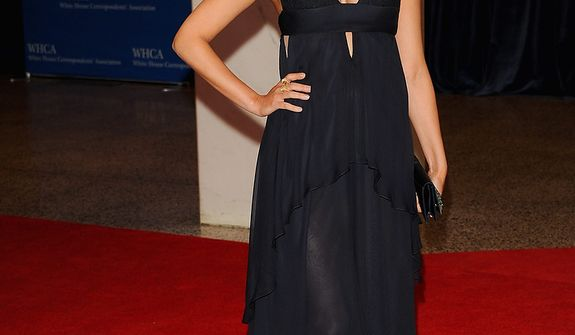 "Actress Morena Baccarin of the Showtime series ""Homeland"" attends tthe White House Correspondents' Association Dinner at the Washington Hilton Hotel on Saturday, April 27, 2013, in Washington. (Evan Agostini/Invision/AP)"