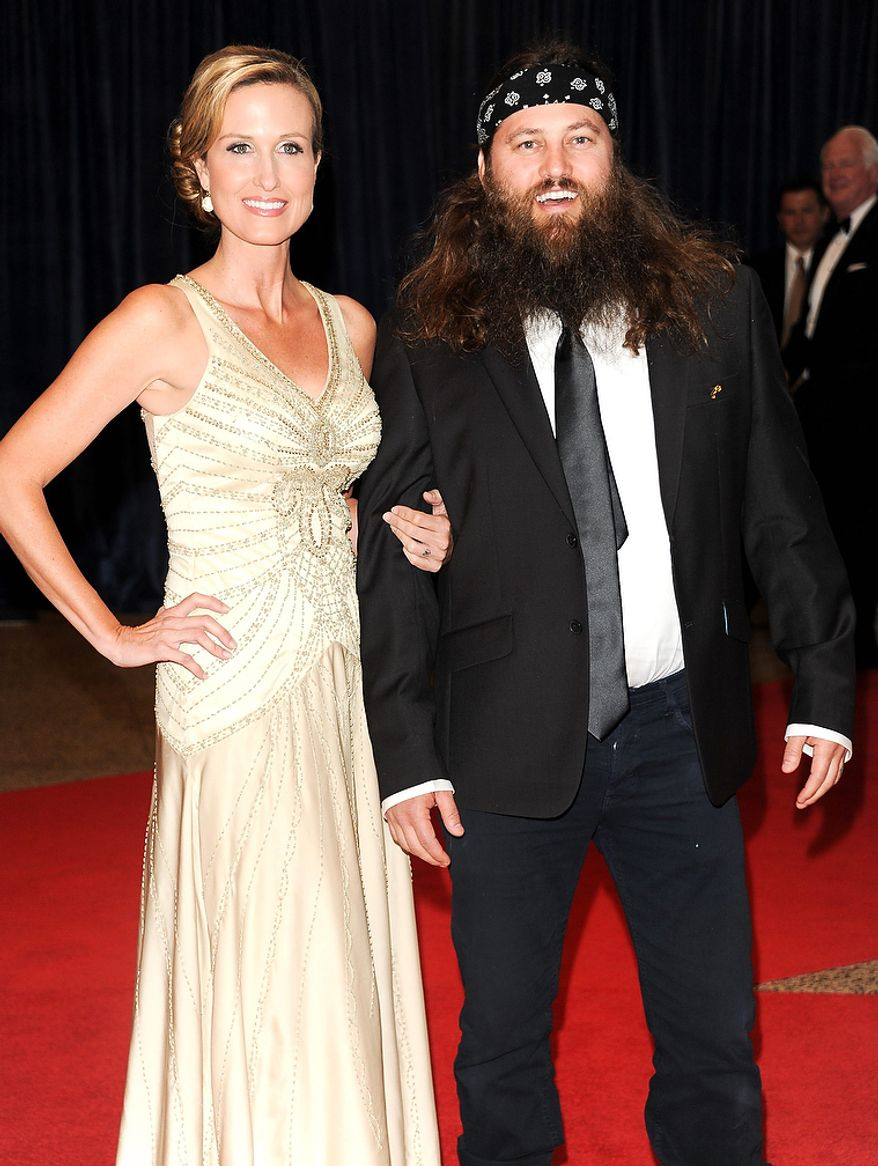 "Korie Robertson (left) and Willie Robertson of the A&E series ""Duck Dynasty"" attend the White House Correspondents' Association Dinner at the Washington Hilton Hotel on Saturday, April 27, 2013, in Washington. (Evan Agostini/Invision/AP)"