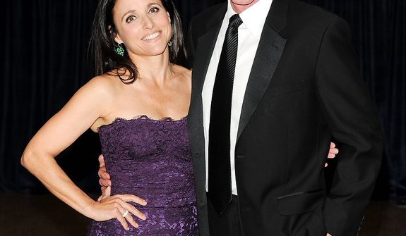 Actress Julia Louis-Dreyfus and her husband, Brad Hall, attend the White House Correspondents' Association Dinner at the Washington Hilton Hotel on Saturday, April 27, 2013, in Washington. (Evan Agostini/Invision/AP)
