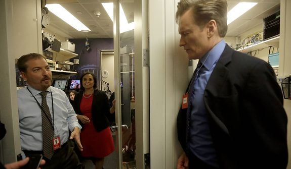 Late-night television host and comedian Conan O'Brien (right) stops to meet NBC News White House Correspondent Chuck Todd (left) and Kristen Welker (center) during his tour of the White House Brady Press Briefing Room and work area for members of the media, on Friday, April, 26, 2013, in Washington. Mr. O'Brien visited the White House ahead of his scheduled hosting of the annual White House Correspondents' Association Dinner on Saturday. (AP Photo/Pablo Martinez Monsivais)