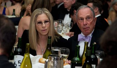 Singer-actress Barbra Streisand (left) and New York Mayor Michael R. Bloomberg attend the White House Correspondents' Association Dinner at the Washington Hilton Hotel on Saturday, April 27, 2013, in Washington. (AP Photo/Carolyn Kaster)
