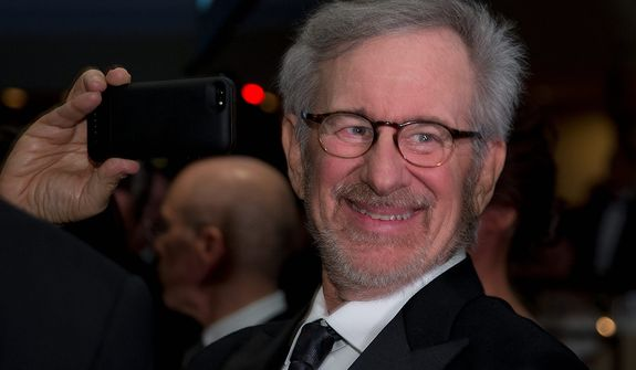 Director Steven Spielberg uses his smartphone during the White House Correspondents' Association Dinner at the Washington Hilton Hotel on Saturday, April 27, 2013, in Washington. (AP Photo/Carolyn Kaster)