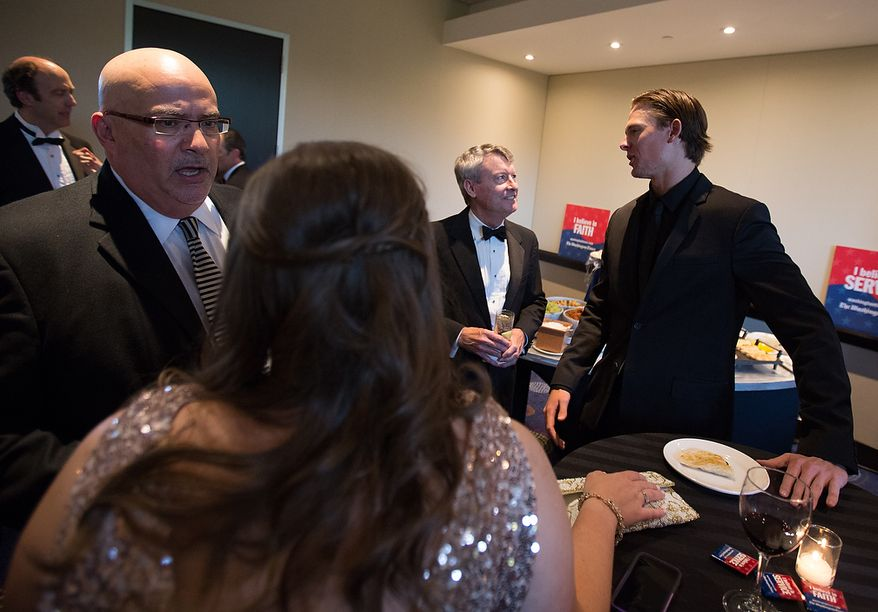 Washington Nationals pitcher Tyler Clippard speaks with Washington Times Editor David S. Jackson at the newspaper's reception at the White House Correspondents' Association Dinner at the Washington Hilton Hotel in Washington on Saturday, April 27, 2013. (Andrew S. Geraci/The Washington Times)