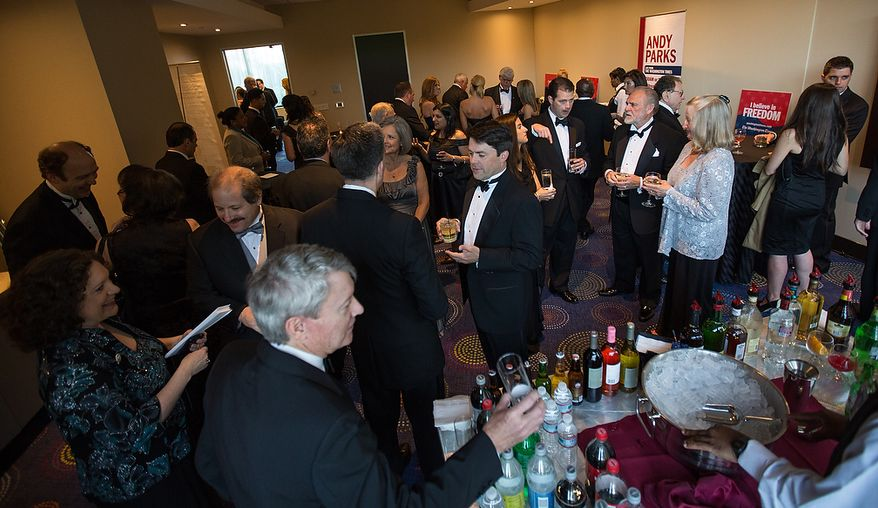 Guest mingle at The Washington Times' reception at the White House Correspondents' Association Dinner at the Washington Hilton Hotel in Washington on Saturday, April 27, 2013. (Andrew S. Geraci/The Washington Times)