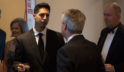 Washington Nationals pitcher Gio Gonzalez speaks with Washington Times Editor David S. Jackson at the newspaper's reception at the White House Correspondents' Association Dinner at the Washington Hilton Hotel in Washington on Saturday, April 27, 2013. (Andrew S. Geraci/The Washington Times)