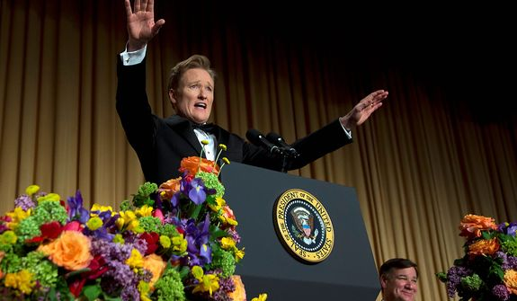 Late-night television host and comedian Conan O'Brien gestures as he speaks during the White House Correspondents' Association Dinner at the Washington Hilton Hotel on Saturday, April 27, 2013, in Washington. (AP Photo/Carolyn Kaster)