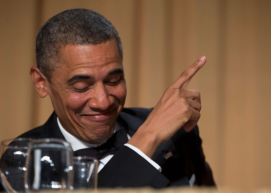 President Obama acknowledges late-night television host and comedian Conan O'Brien during the White House Correspondents' Association Dinner at the Washington Hilton Hotel on Saturday, April 27, 2013, in Washington.  (AP Photo/Carolyn Kaster)