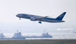 """A Boeing 787 """"Dreamliner"""" aircraft belonging to Japan's All Nippon Airways takes off from Haneda Airport in Tokyo at the start of a test flight on Sunday, April 28, 2013. (AP Photo/Kyodo News)"""