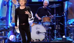 ** FILE ** Lead singer Mick Jagger (left) and drummer Charlie Watts of the Rolling Stones perform at the Prudential Center in Newark, N.J., on Saturday, Dec. 15, 2012. (Evan Agostini/Invision/AP)