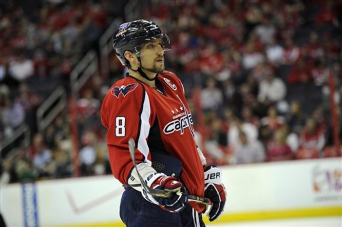 Washington Capitals left wing Alex Ovechkin (8), of Russia, looks on during the first period of an NHL hockey game against the Ottawa Senators, Thursday, April 25, 2013, in Washington. (AP Photo/Nick Wass)