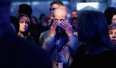 Sol Freedman [cq], center, gets emotional during the U.S. Holocaust Memorial Museum's 20th Anniversary Commemoration and National Tribute to Holocaust Survivors and World War II Veterans, Washington, D.C., Monday, April 29, 2013. (Andrew Harnik/The Washington Times)