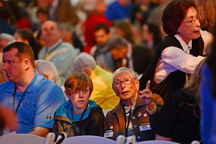 Ilse F. Camis, a Holocaust survivor from Vienna, Austria, sits with her great-great-grandson Thomas Gorenflo III, 12, of Detroit, before the start of the commemoration ceremony. (Andrew Harnik/The Washington Times)
