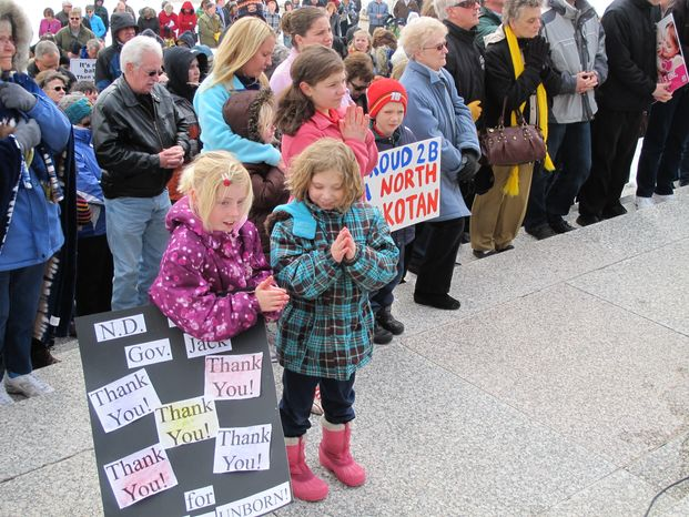 **FILE** A crowd prays at an anti-abortion rally at the state Capitol in Bismarck, N.D., on April 17, 2013. Organizers say the rally was held to thank North Dakota lawmakers and Gov. Jack Dalrymple for passing measures th