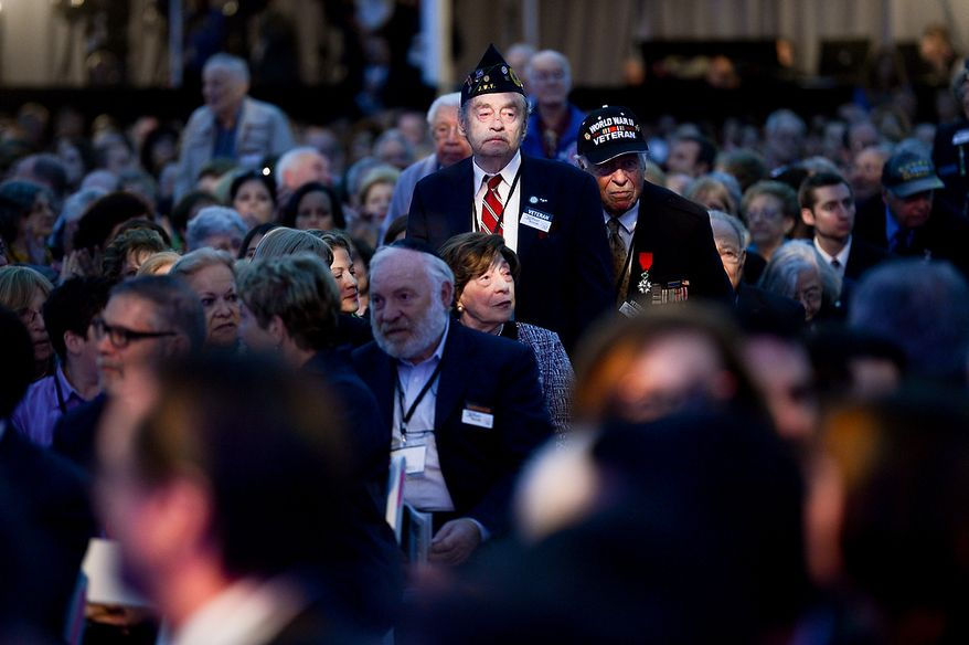 World War II veterans stand in the audience as they are recognized during the U.S. Holocaust Memorial Museum's 20th-anniversary commemoration and national tribute to Holocaust survivors and World War II veterans in Washington on Monday, April 29, 2013. (Andrew Harnik/The Washington Times)