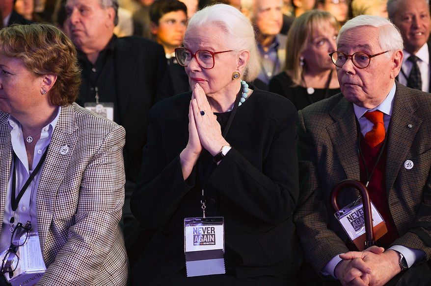 Audience members listen to speakers during the U.S. Holocaust Memorial Museum's 20th-anniversary commemoration and national tribute to Holocaust survivors and World War II veterans in Washington on Monday, April 29, 2013. (Andrew Harnik/The Washington Times)
