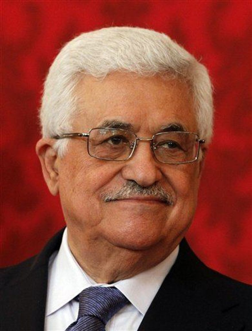 Palestinian leader Mahmoud Abbas speaks to press in the Hofburg palace in Vienna, Austria, Tuesday, April 30, 2013. (AP Photo/Ronald Zak)