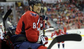 Washington Capitals left wing Alex Ovechkin (8), of Russia, looks on from the bench area during the first period of an NHL hockey game against the Boston Bruins, Saturday, April 27, 2013, in Washington. (AP Photo/Nick Wass)