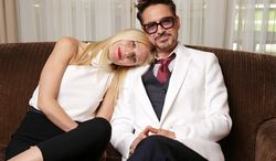 """There's something of the old married couple about Gwyneth Paltrow and Robert Downey Jr., though they're married to other people. They're cozy and comfy sitting down together for an interview in Los Angeles to promote """"Iron Man 3,"""" opening Friday. (Photo by Eric Charbonneau/Invision/AP)"""