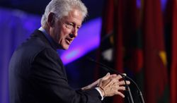 Former President Bill Clinton speaks at the 20th anniversary of the United States Holocaust Memorial Museum in Washington on Monday, April 29, 2013. (Associated Press)
