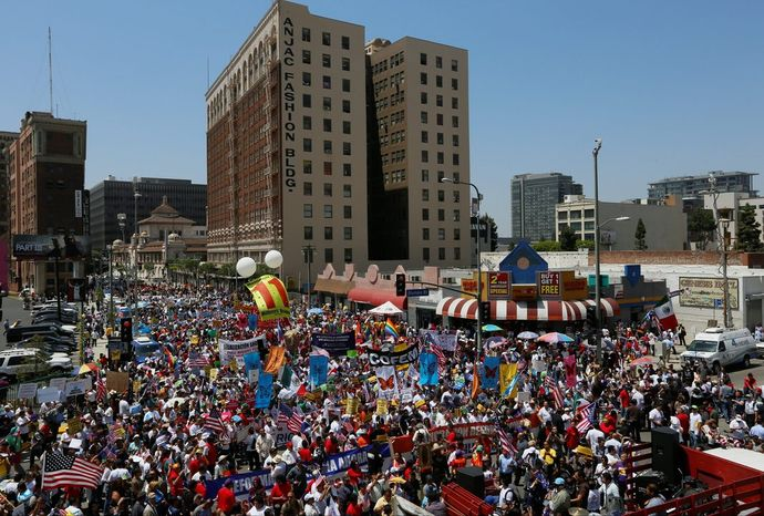 Thousands of people march during a May Day immigration rally in Los Angeles on Wednesday. The Senate is crafting an immigration reform bill. (Associated Press photographs)