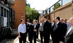 Syrian President Bashar Assad makes a rare public appearance Wednesday with a visit to the Umayyad Electrical Station in Damascus, the day after a large explosion.