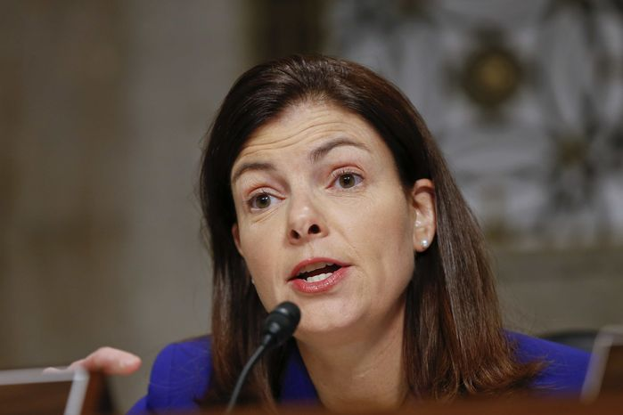 ** FILE ** Senate Armed Services Committee member Sen. Kelly Ayotte, R-N.H., questions former Nebraska Republican Sen. Chuck Hagel, President Obama's choice to lead the Pentagon, during his confirmation hearing on Capitol Hill in Washington, in this Jan. 31, 2013 file photo. A woman whose mother was killed in last year's school shooting in Newtown, Conn., confronted Ms. Ayotte Tuesday, April 30, 2013, during the senator's first public appearance in New Hampshire since voting against gun control legislation. (AP Photo/J. Scott Applewhite, File)