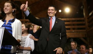 **FILE** Gabriel Gomez (center), Republican candidate for the U.S. Senate from Massachusetts, gives a thumbs up as he takes to the stage next to his daughter Olivia (left), 13, before addressing an audience at a watch party in Cohasset, Mass., on Tuesday, April 30, 2013, after winning the GOP primary. (Associated Press)