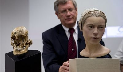 """The Smithsonian's Doug Owsley displays the skull and facial reconstruction of  """"Jane of Jamestown"""" at the National Museum of Natural History in Washington, where scientists presented evidence that some of the earliest American colonists at Jamestown, Va., survived harsh conditions by turning to cannibalism. (AP Photo/Carolyn Kaster)"""