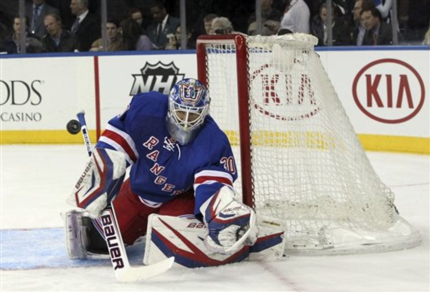 New York Rangers goalie Henrik Lundqvist, of Sweden, catches the puck during the first period of the NHL hockey game against the Florida Panthers, Thursday, April 18, 2013 at Madison Square Garden in New York. The Ranges won 6-1. (AP Photo/Mary Altaffer)