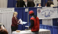Kathie Maiello (left) of Any-Time Home Care talks with Jashod Chaney of Albany, N.Y., at the Dr. King Career Fair at the Empire State Plaza Convention Center in Albany on Thursday, April 11, 2013. (AP Photo/Mike Groll)