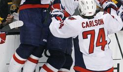 Joel Ward (center) scored the game-winning goal in Game 7 of last year's playoff matchup against Boston. (Associated Press)