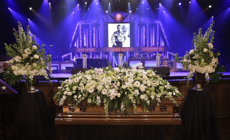 The casket of country music legend George Jones sits in the Grand Ole Opry House before his funeral on Thursday, May 2, 2013, in Nashville, Tenn. Mr. Jones, one of country's biggest stars, who had No. 1 hits in four differ