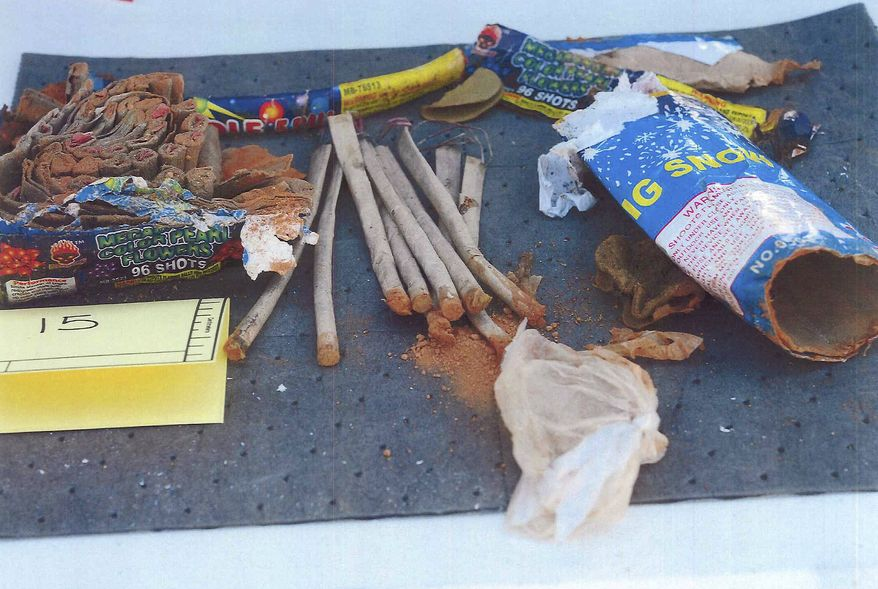 This photo released May 1, 2013, by the U.S. Attorney's office in a federal criminal complaint, shows fireworks, which the complaint said federal agents recovered from inside a backpack belonging to Boston Marathon bombing suspect Dzhokhar Tsarnaeva, found in a landfill in New Bedford, Mass. Three men who attended the University of Massachusetts at Dartmouth with Tsarnaeva, were charged Wednesday, May 1, 2013, in connection with the case. (AP Photo/U.S. Attorney's Office)