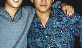 """**FILE** This 1988 photo provided by Bobby Lee shows Kenneth Bae (right) and Mr. Lee together when they were freshmen at the University of Oregon. Bae, detained for nearly six months in North Korea, has been sentenced to 15 years of """"compulsory labor"""" for unspecified crimes against the state, Pyongyang announced on May 2, 2013. (Associated Press/The Register-Guard)"""
